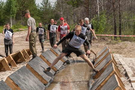 carry out: Tyumen, Russia - June 11, 2016: Race of Heroes project on the ground of the highest military and engineering school. Participants carry out anti-gravitation exercise Editorial