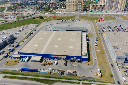industrial park: Tyumen, Russia - May 27, 2016: Aerial view onto Metro cash and carry trading center and road construction on Fedyuninskogo and Melnikayte streets intersection Editorial