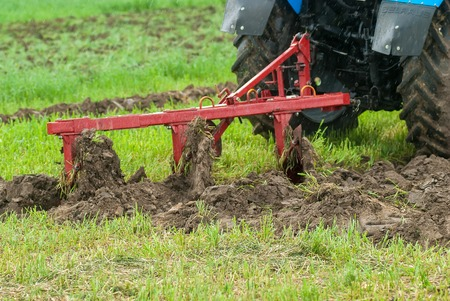agronomic: Tyumen, Russia - June 24, 2016: The 5th open championship of Russia on a plowed land. Hinged equipment for tractor demonstration