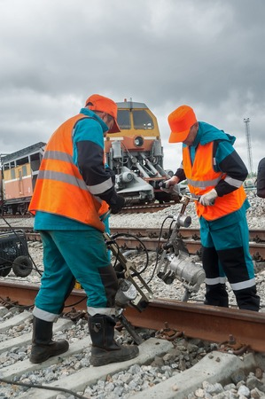 cross ties: Tobolsk, Russia - July 15. 2016: Sibur company. Railway workers repairing rail