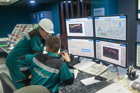 Tobolsk, Russia - July 15. 2016: Sibur company. Central control panel of Tobolsk Polymer plant. The engineering personnel watch in monitors work of the equipment Editorial