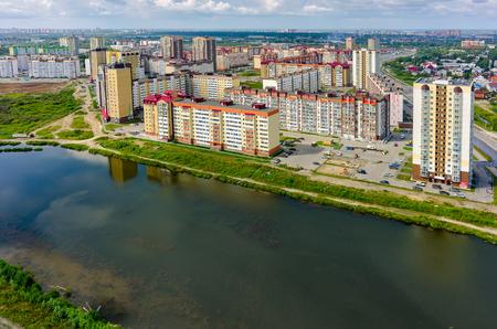 Tyumen, Russia - July 29, 2015: Aerial view on city quarters. Tura neighborhood