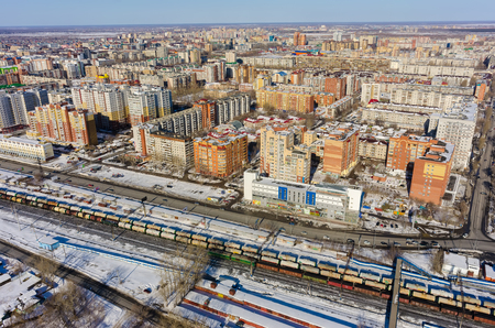 Tyumen, Russia - March 11, 2016: The railroad along 50 let VLKSM Street and residential district Editorial