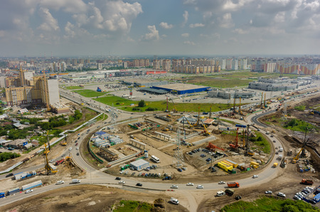 highway traffic: Tyumen, Russia - July 29, 2016: Construction of two-level outcome on bypass road on Fedyuninskogo and Melnikayte streets intersection