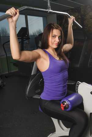 powerlifting: fitness, sport, powerlifting and people concept - sporty woman exercising in gym