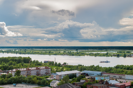 transported: Tobolsk, Russia - July 15, 2016: Little ferry is transported through Irtysh river