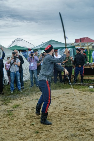 possession: Tyumen, Russia - June 24, 2016: The 5th open championship of Russia on a plowed land. Cossack shows skill of sabre possession Editorial