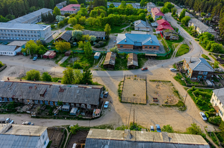 parking facilities: Tyumen regional clinical psychiatric hospital and residential settlement. Aerial view Stock Photo
