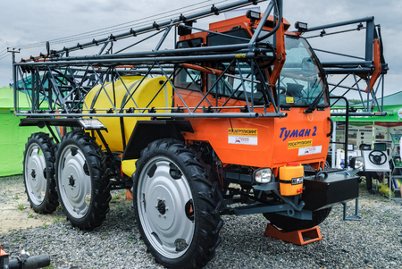 traction: Tyumen, Russia - June 24, 2016: The 5th open championship of Russia on plowed land. Sprayer spreader self-propelled Tuman-2 for entering of fertilizer in liquid and granulated form