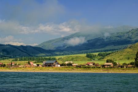 Tyungur village on Katun river shore in Mountain Altai. Russia