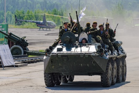 armoured: Nizhniy Tagil, Russia - July 12. 2008: Group of special forces unload from BTR-82A armoured personnel carrier on shooting demonstration range Editorial