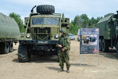 Tyumen, Russia - June 11, 2016: Cadet of Tyumen highest military and engineering command school in Polite people uniform near TMM-3 mechanized bridge vehicle Redakční