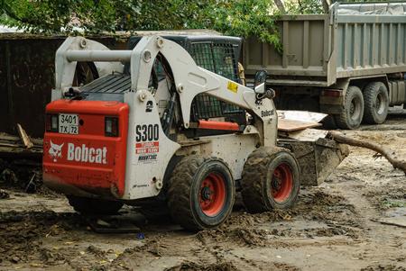 skid: Tyumen, Russia - September 15, 2007: skid loader working on road construction