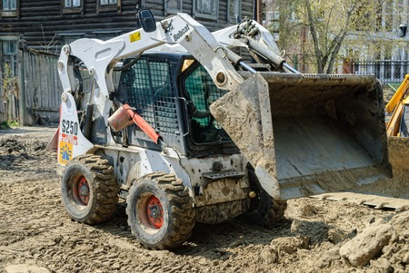 skid: Tyumen, Russia - May 5, 2007: skid loader working on road construction Editorial