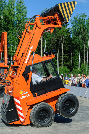 skid: Nizhniy Tagil, Russia - July 12. 2008: RAE-2008 exhibition. Show program of skid loader