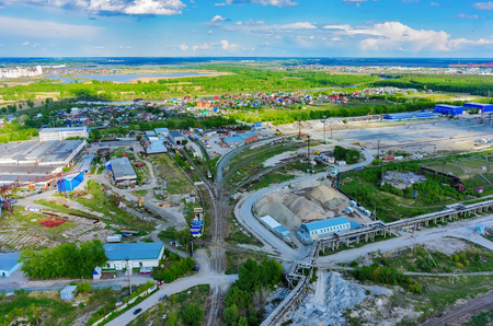 electricity export: Tyumen, Russia - May 19, 2015: Tyumen machine-tool factory and territory of logistic firm on transportation of construction materials