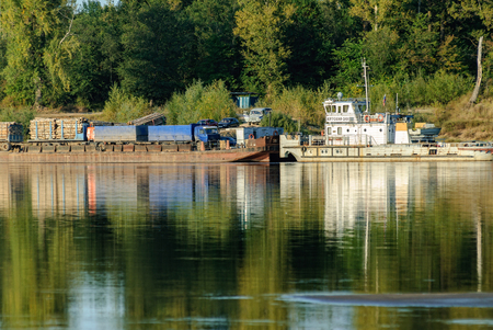 near Malmyzh, Russia - September 3, 2009: The car ferry sails away from the coast to cross the Vyatka River Editorial