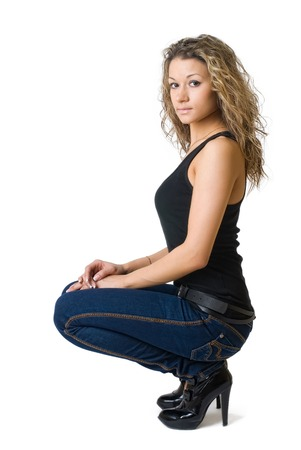 Beautiful woman in stylish denim clothing. Isolated over white photo