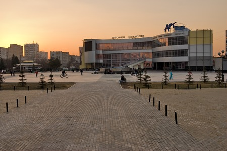 Tyumen, Russia - April 22, 2010: Twilight view onto Art Palace. Because of mistakes in design the bases hasn't been open, and now it is demolished photo