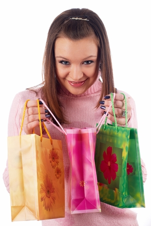 Young attractive woman with bags after shopping