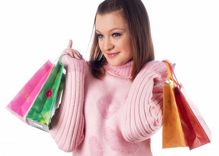 Young attractive woman smiles with bags after shopping over isolated background Stock Photo