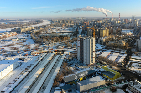 residental: Tyumen, Russia - December 2, 2015: Aerial view on Aurora residential area construction with combined heat and power factory on background