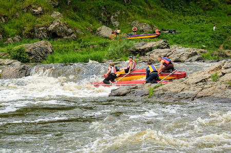 Beklenischevo, Russia - June 12, 2005: The place with the Iset River rapid current, a so-called threshold the Revun - Howler . Water tourists move on rapid river in threshold