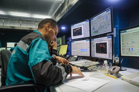 power production: Tobolsk, Russia - July 15. 2016: Sibur company. Central control panel of Tobolsk Polymer plant. The engineering personnel watch in monitors work of equipment