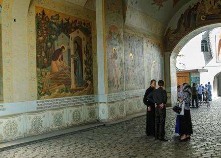 priests: Sergiev Posad, Russia - September 1, 2009: Priests in Trinity Sergius Lavra (monastery). Popular touristic landmark, UNESCO World Heritage Site Editorial