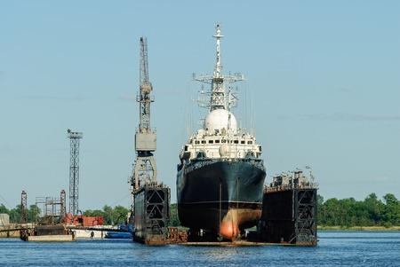 shipbuilding: Baltiysk, Russia - June 29, 2010: The great ship under renovation in the yard