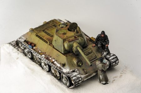 diorama: Legendary Soviet tank T-34 at war in the second world war. Diorama of winter view with officers