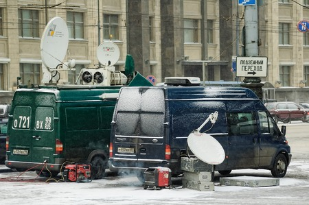 duma: Moscow, Russia - January 20, 2005: TV broadcast cars stand near State Duma in winter day