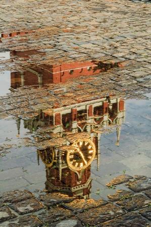 Reflection in pool of Spasskaya tower of Moscow Kremlin