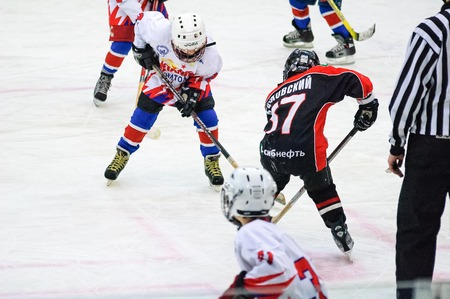 Tyumen, Russia - April 14, 2013: Hockey tournament on prize of name A.P.Vahrin among teams of children till 9 years old. Game between the Gazovik 04 (Tyumen) and DYuSSh Metallurg 04 (Novokuznetsk).