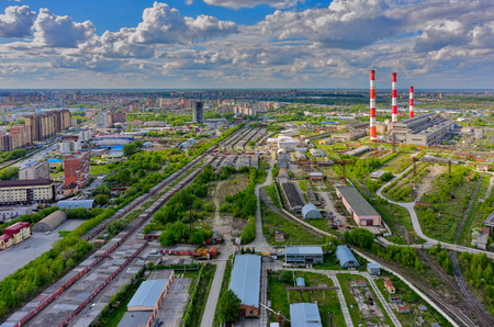 fuel and power generation: Aerial view of modern combined heat and power plant. Fuming chimney with sulphur removal unit. Heavy industry from above. Power and fuel generation in Tyumen. Russia Stock Photo