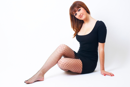 Beautiful red-haired girl on floor photo