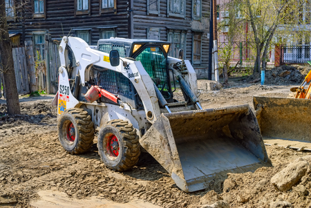 Tyumen, Russia - May 5, 2007: skid loader working on road construction Editorial