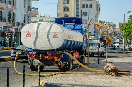 Hurghada, Egypt - November 6, 2006: Sewerage truck on street working - clean up sewerage overflows, cleaning pipelines and potential pollution issues 報道画像