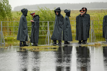 Tyumen, Russia - July 30, 2006: City Day. Police officers stand in cordon in rainy weather Editorial