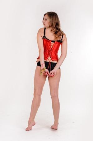 Beautiful sexy woman in corset. Back view Stock Photo
