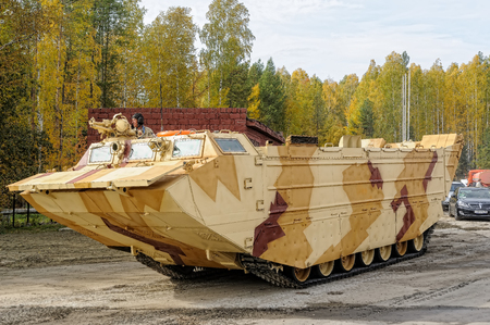 amphibious: Nizhniy Tagil, Russia - September 25. 2013: Tracked amphibious carrier PTS-4 move on the demonstration range. RAE-2013 exhibition Editorial
