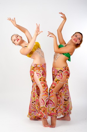 Beautiful girls in belly dance costume over white background photo