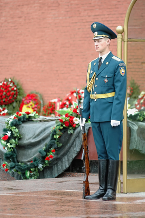 Moscow, Russia - May 12, 2006: Changing guard soldiers in Alexanders garden near eternal flame at the Tomb of the Unknown Soldier