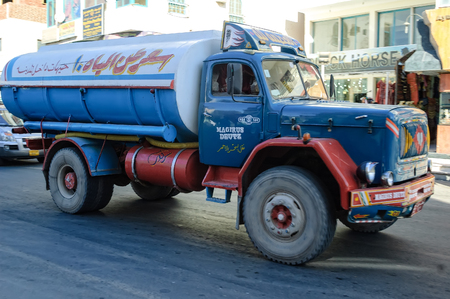 Hurghada, Egypt - November 7, 2006: Old tank truck driven by arabian driver moves on city street