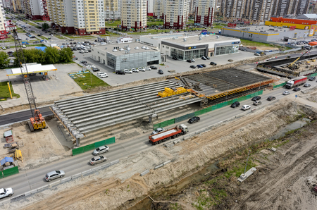 outcome: Tyumen, Russia - June 1, 2017: Construction of two-level outcome on bypass road on Fedyuninskogo and Permyakova streets intersection