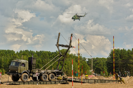 assemblage: Tyumen, Russia - June 21, 2017: Army Games. Safe Route contest. Assemblage of the mechanized bridge from TMM set Editorial