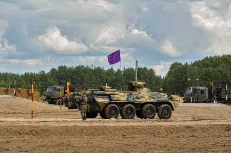 infantry: Tyumen, Russia - June 21, 2017: Army Games. Safe Route contest. The BTR-82 amphibious armoured personnel carrier in action