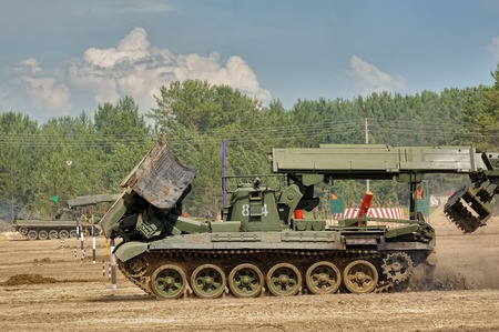 Tyumen, Russia - June 21, 2017: Army Games. Safe Route contest. Passage making by IMR engineer vehicle Editorial