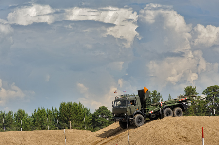 Tyumen, Russia - June 21, 2017: Army Games. Safe Route contest. Motion of the mechanized bridge from TMM set Redakční