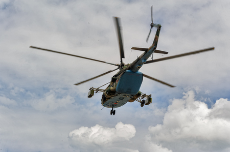 Tyumen, Russia - June 21, 2017: Army Games. Safe Route contest. Military helicopter MI-8 in the cloudy sky